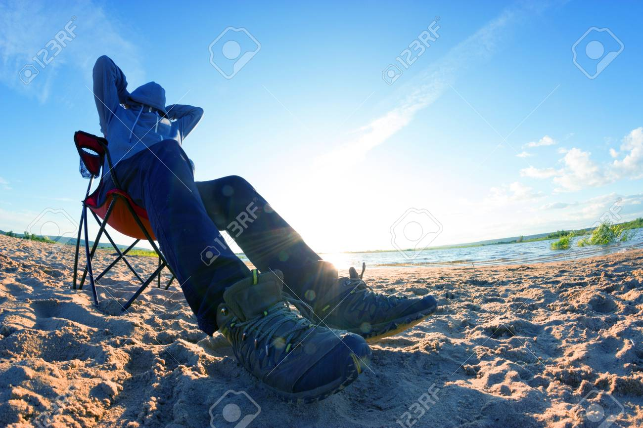 Man Sit In Beach Chair In Warm Clothes Low Season Cold Weather Stock Photo Picture And Royalty Free Image Image 91838940