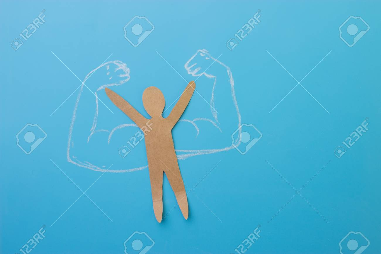 paper man with muscles. self confidence concept - 101853389