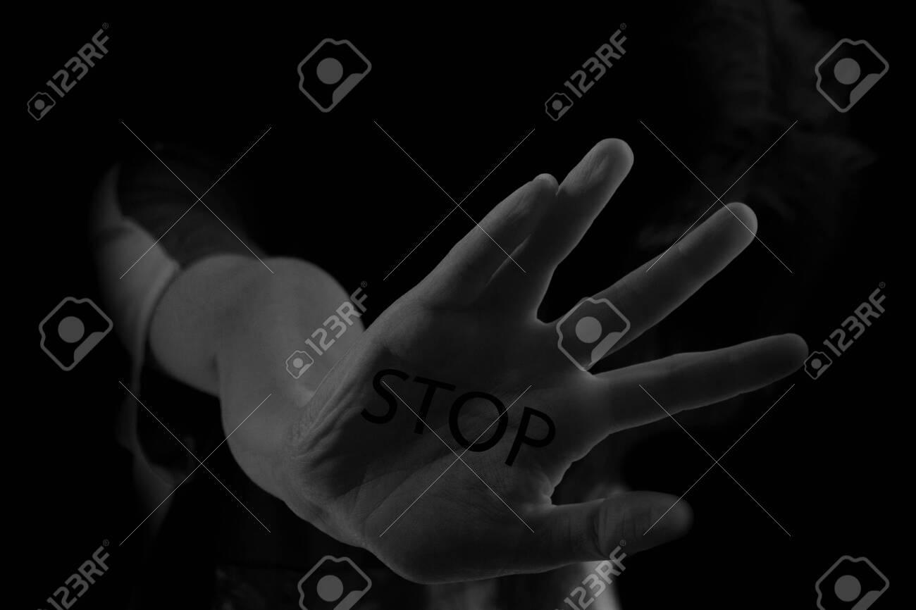 stop concept image. Woman shows stop gesture - 129624369