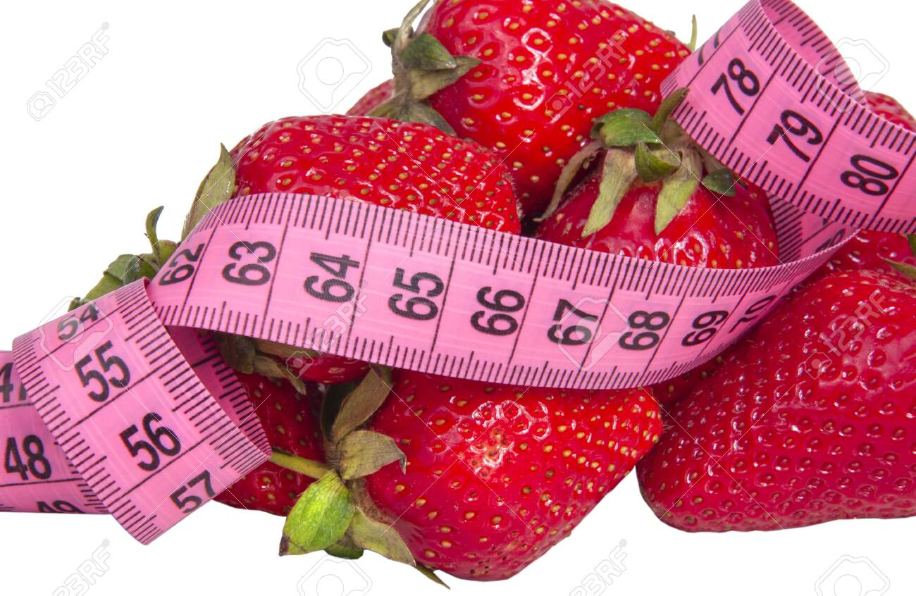 Red fresh strawberry with tape measure isolated on the white - 152134821