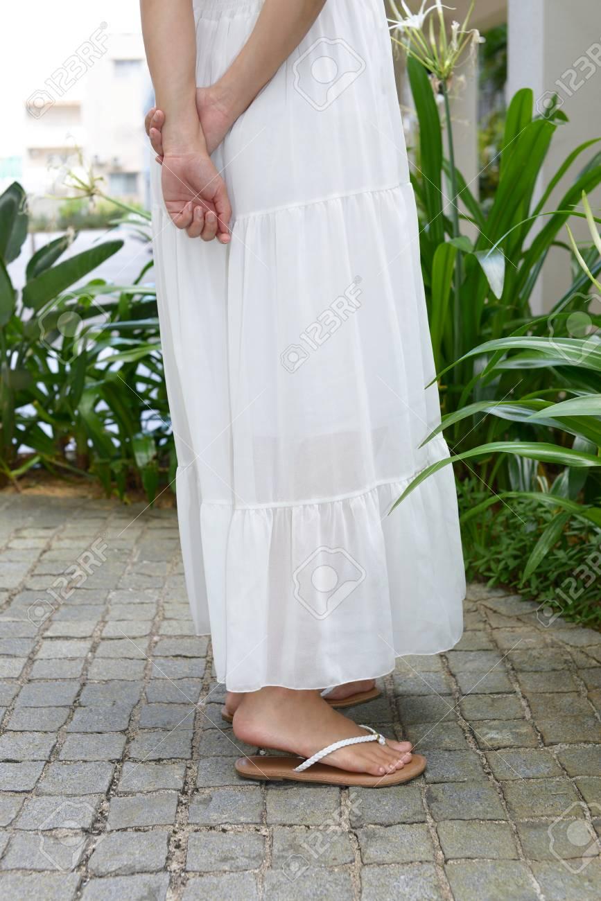 69e932326 Woman in white dress Stock Photo - 94920607