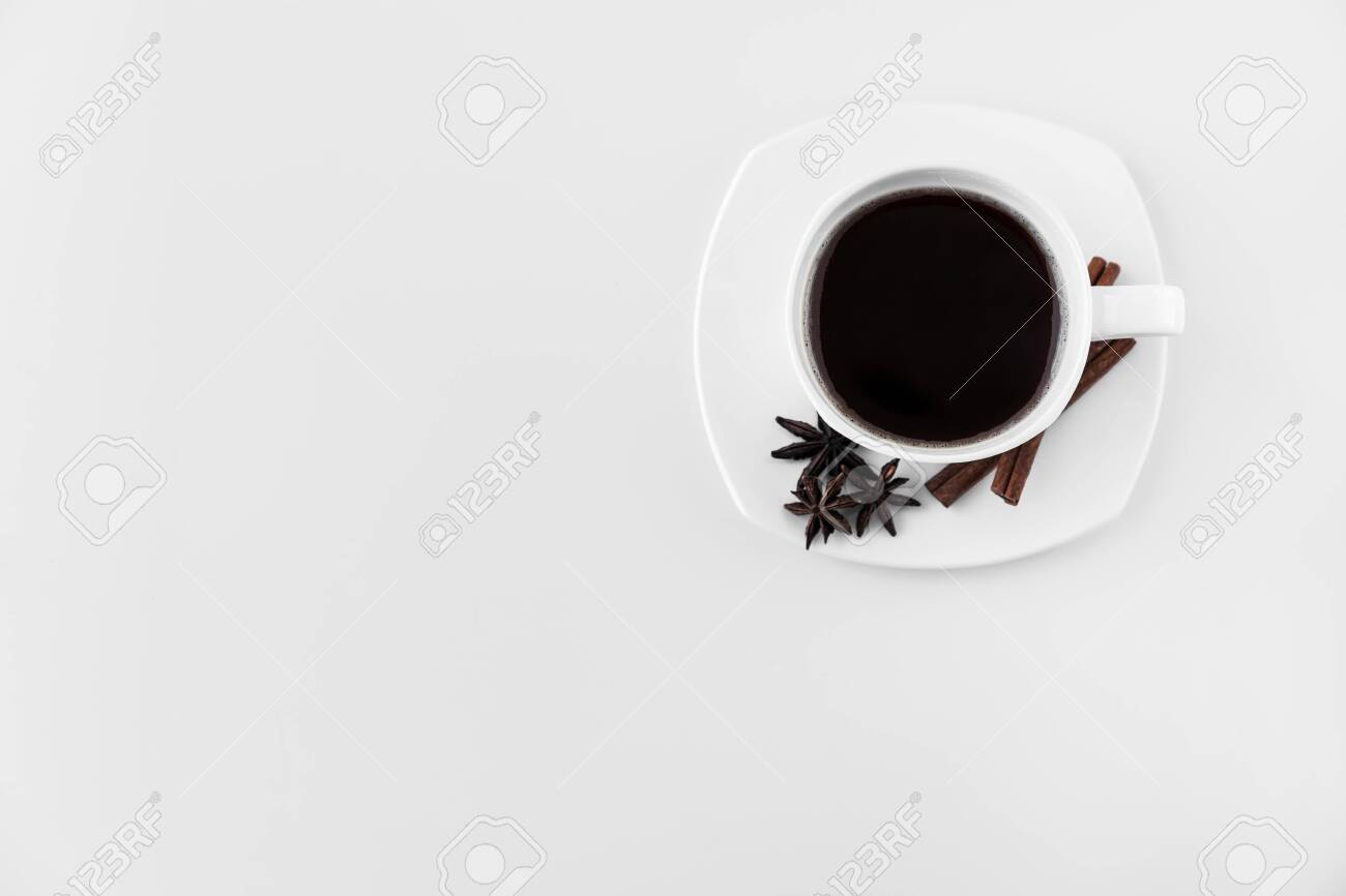 White Cup With Coffee And Saucer With Three Star Anise Star Stock Photo Picture And Royalty Free Image Image 144461547