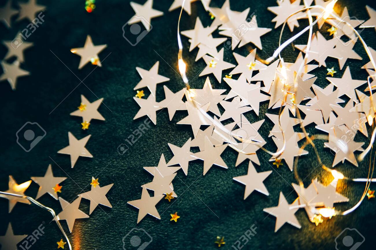 Bright Golden Stars On A Dark Green Velvet Background Christmas Stock Photo Picture And Royalty Free Image Image 136432792