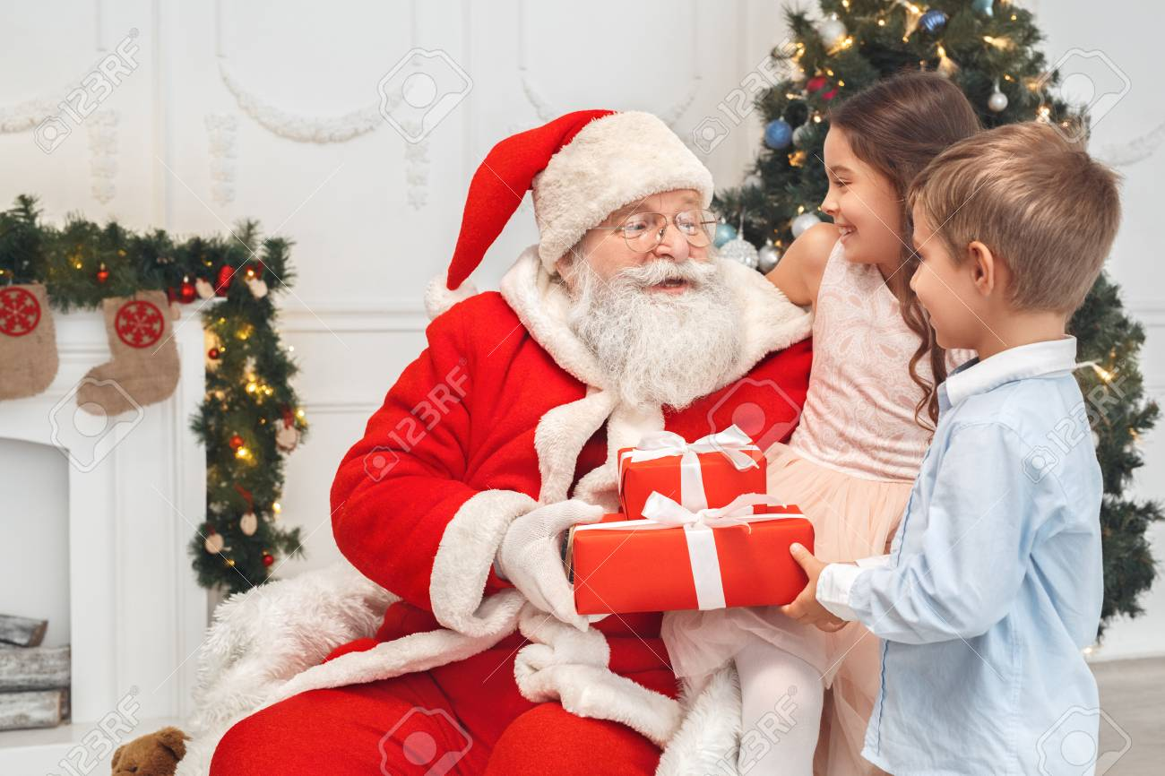Santa Claus With Kids Indoors Christmas Celebration Concept Stock Photo Picture And Royalty Free Image Image 91876511