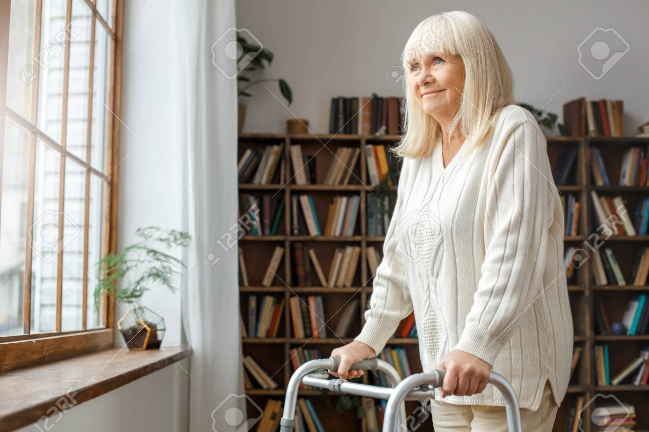 Senior Woman With Disability Recovery At Home Walking Frames.. Stock ...