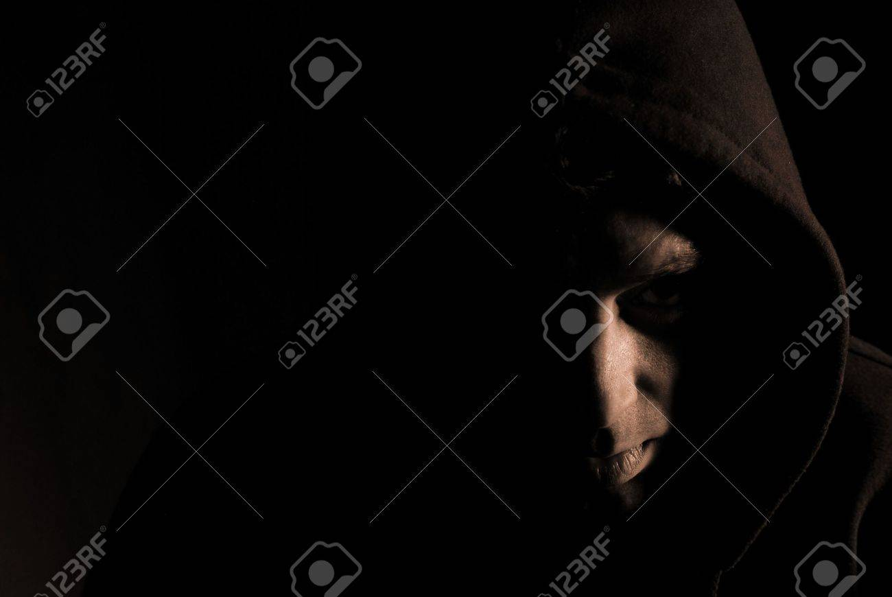 Sepia image of hooded man in shadow Stock Photo - 5111193