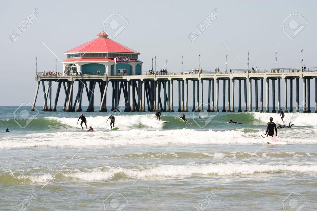 Surfers at the Huntington Beach pier Stock Photo - 1229292