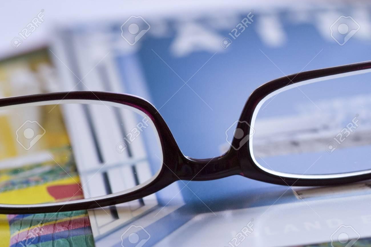 dc9610b027 stylish reading glasses on magazine cover Stock Photo - 2861686