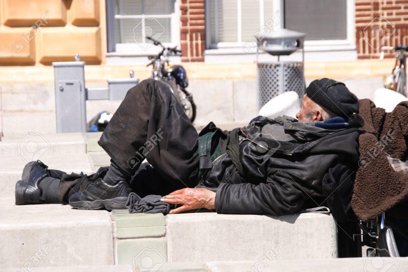 Homeless man sleeping on the sidewalk Stock Photo - 10484648