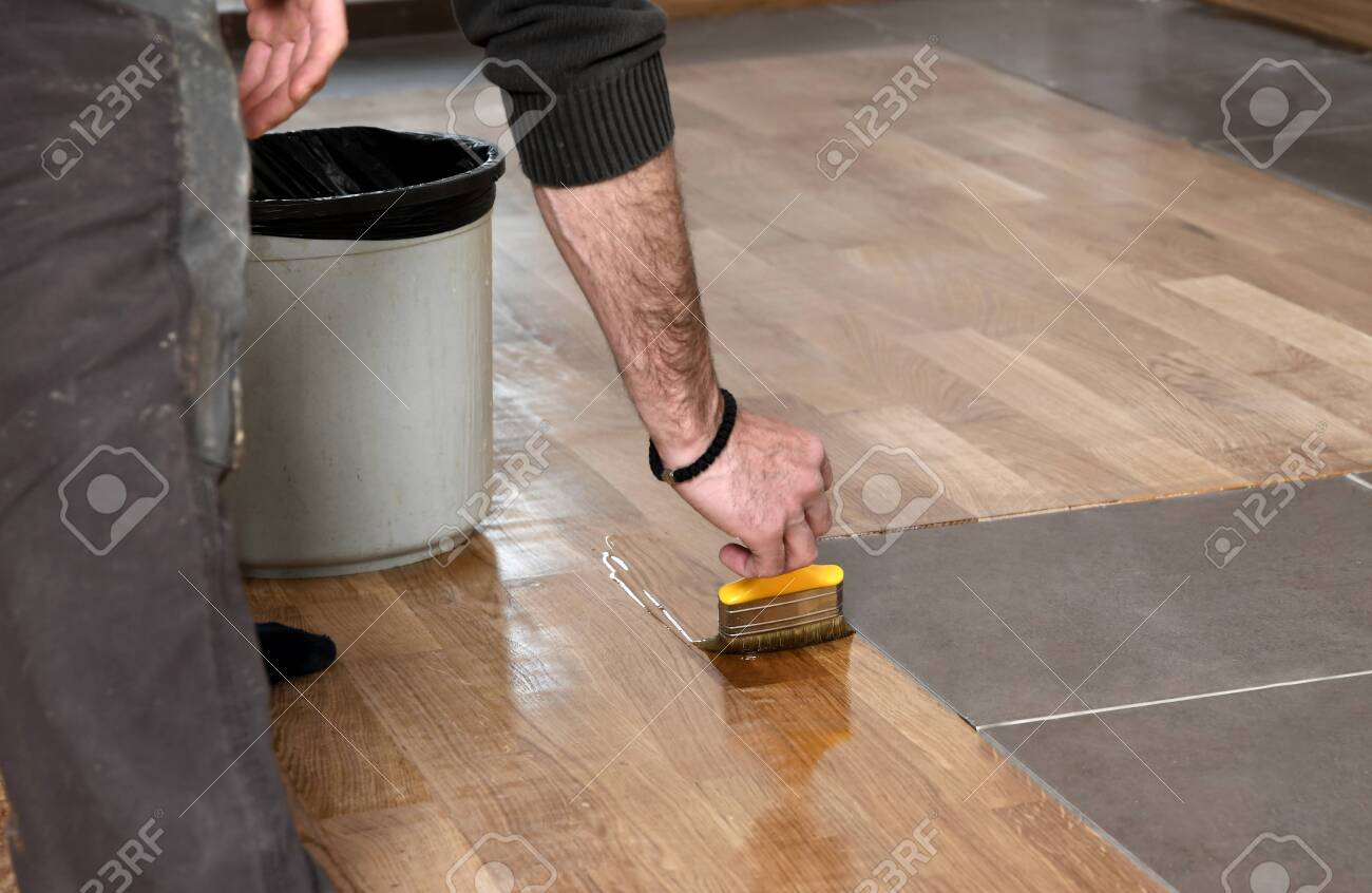 Varnishing Lacquering Parquet Floor By Paintbrush Second Layer