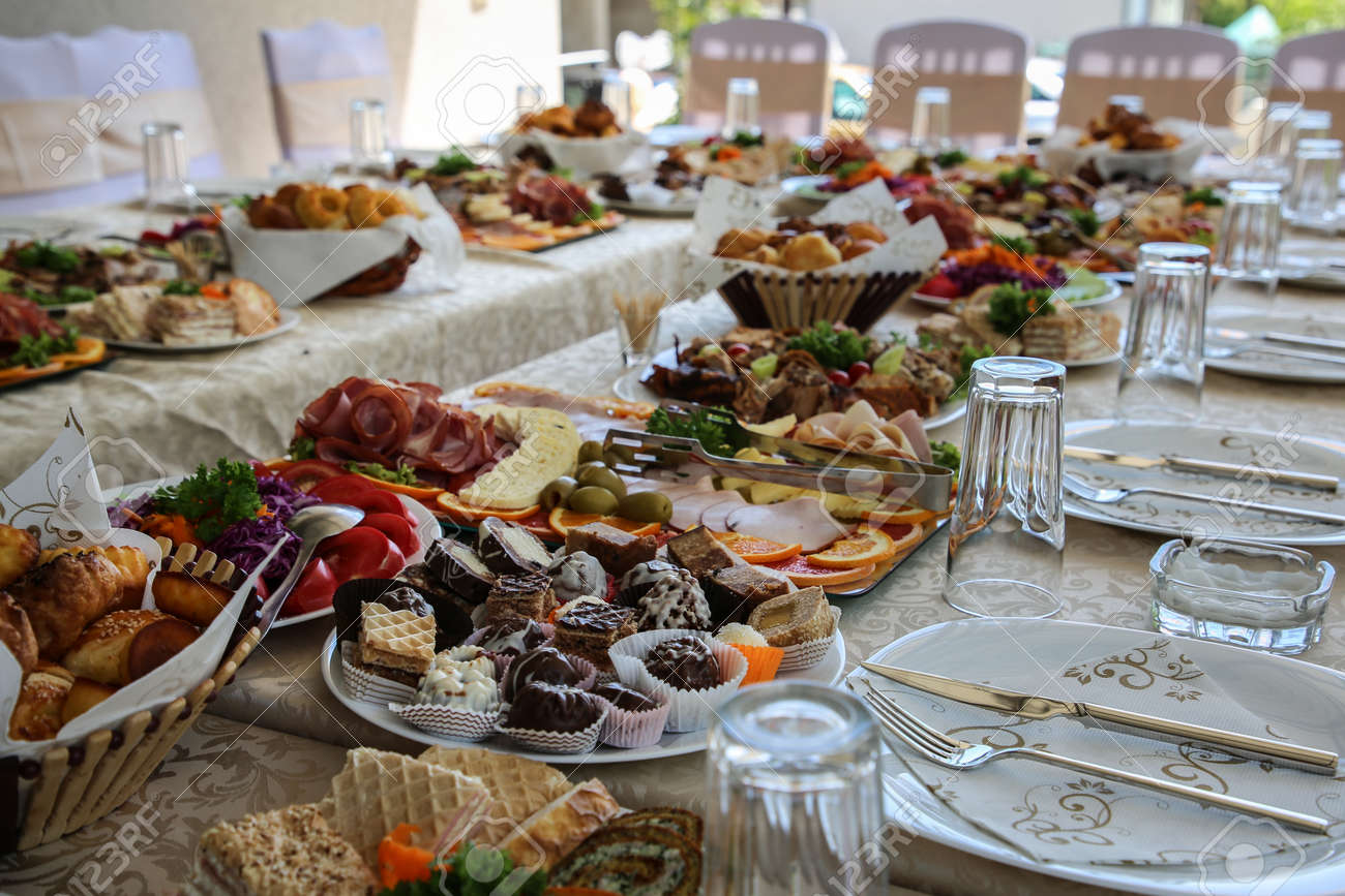 Served table, filled with very tasty and varied food, cutlery. Special wedding concept - 159199148