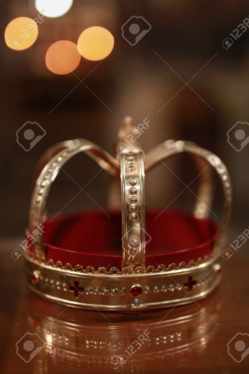 Church attributes for wedding ceremony. Gold crown on the altar. Wedding concept - 162009070
