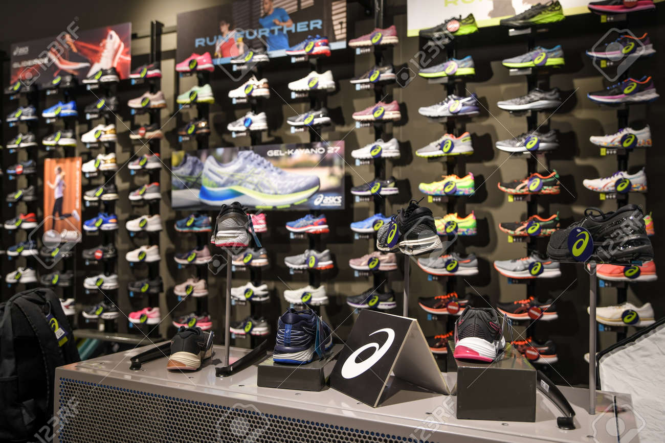 Skopje, North Macedonia - March 12, 2021: Asics store in Skopje, North Macedonia. Asics is a Japanese multinational company which produces footwear and sports equipment - 166241066