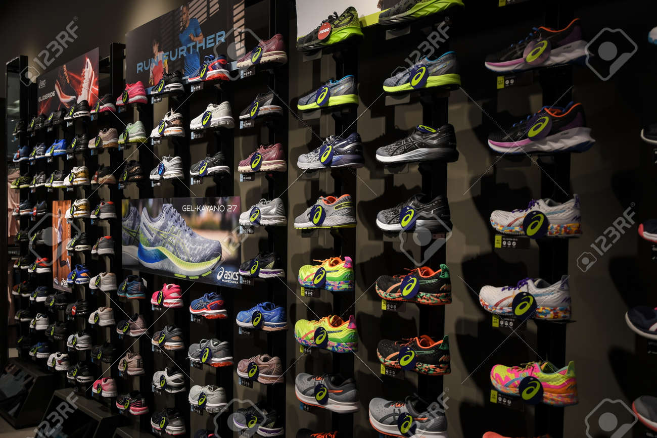 Skopje, North Macedonia - March 12, 2021: Asics store in Skopje, North Macedonia. Asics is a Japanese multinational company which produces footwear and sports equipment - 166241064