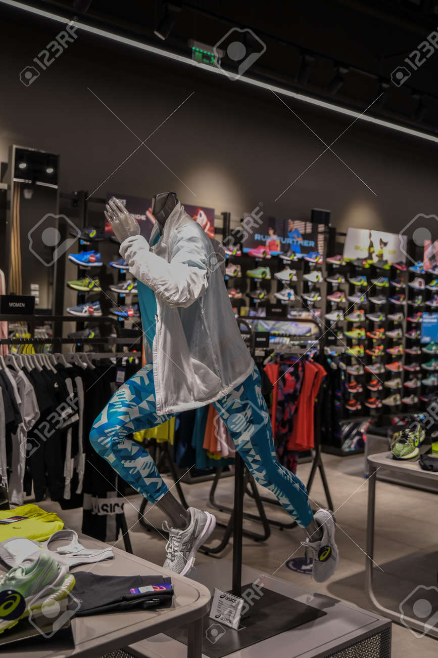 Skopje, North Macedonia - March 12, 2021: Asics store in Skopje, North Macedonia. Asics is a Japanese multinational company which produces footwear and sports equipment - 166241061