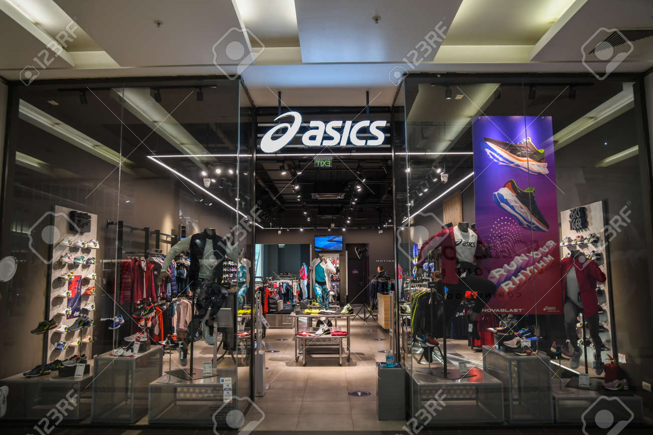 Skopje, North Macedonia - March 12, 2021: Asics store in Skopje, North Macedonia. Asics is a Japanese multinational company which produces footwear and sports equipment - 166241063