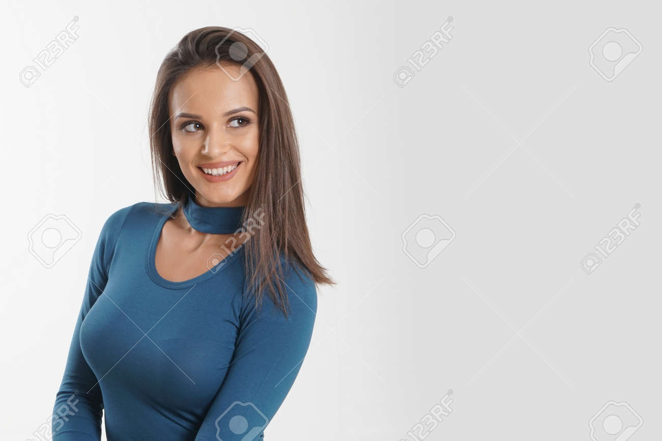 Portrait of an emotionally beautiful woman laughing while looking to the side. Beauty face portrait. Beautiful model girl with perfect fresh clean skin. Concept for youth and skin care - 166482594