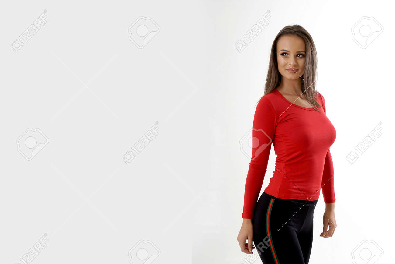 Portrait of an emotionally beautiful woman laughing while looking to the side. Beauty face portrait. Beautiful model girl with perfect fresh clean skin. Girl with red blouse and black tracksuits - 166560970