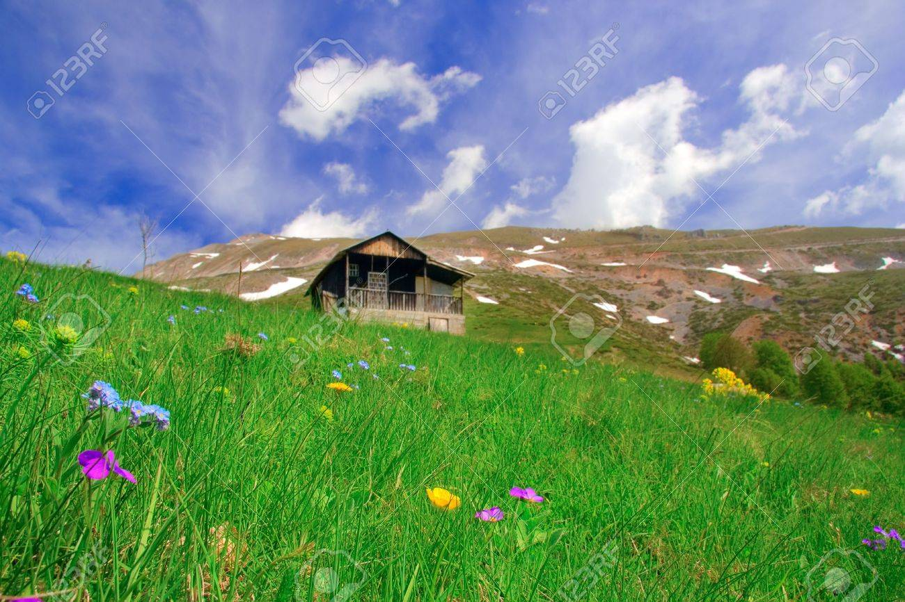 Cabin up in the mountains and a meadow, Macedonia Stock Photo - 491838