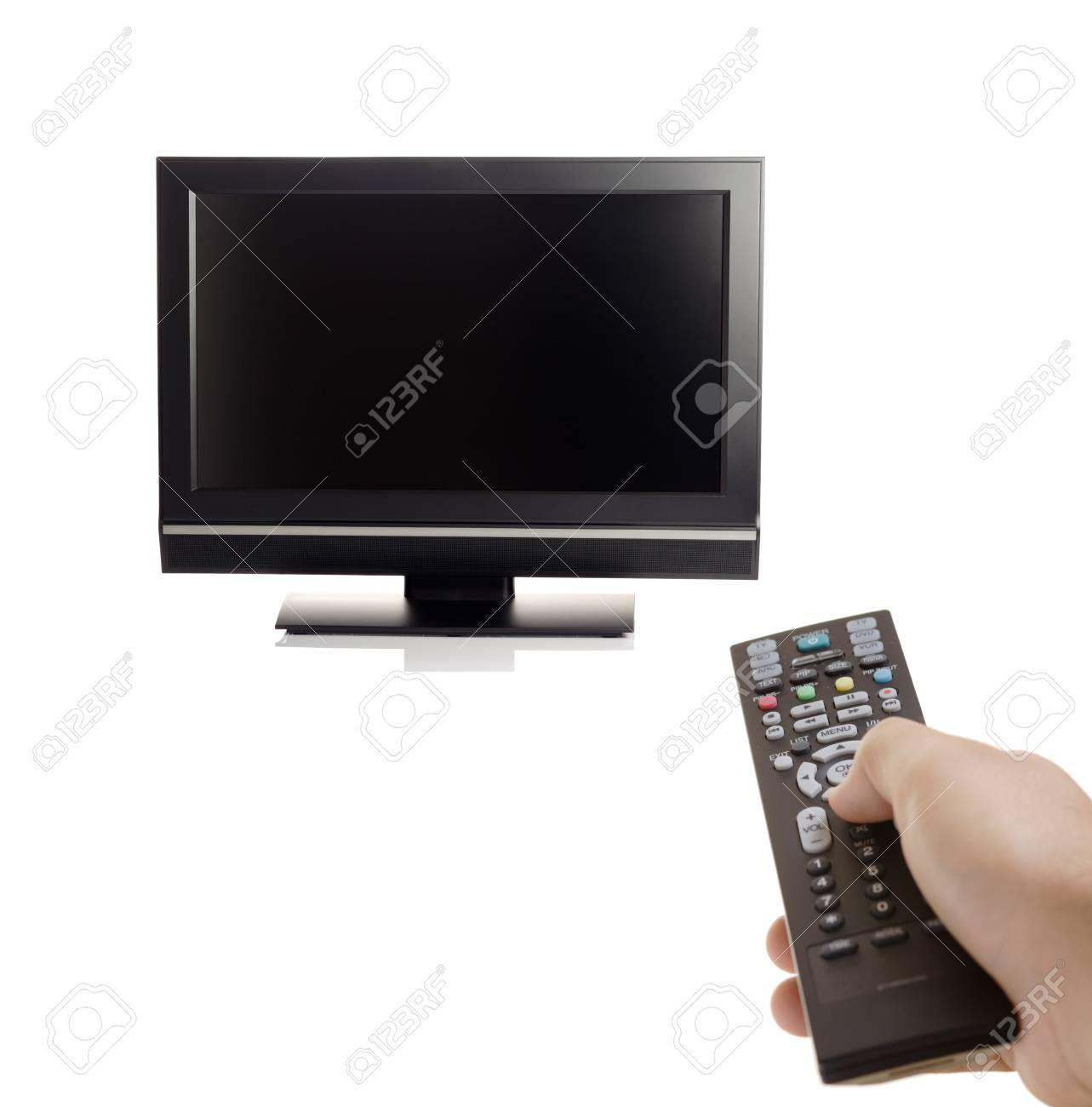 TV set and a person with a remote in his hand Stock Photo - 1646498
