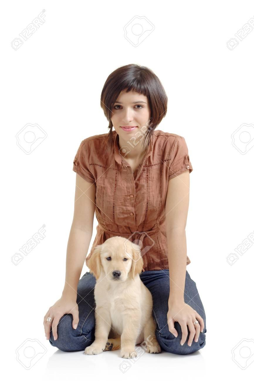 Girl and a golden retriever puppy Stock Photo - 1767913