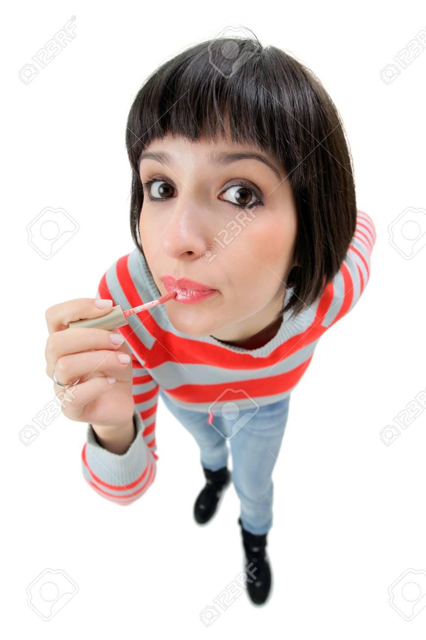 Female putting on make-up Stock Photo - 2349912