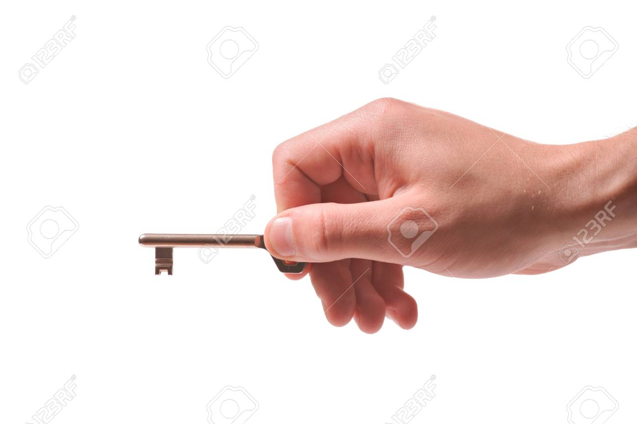 Person holding a door key isolated on white Stock Photo - 2789423