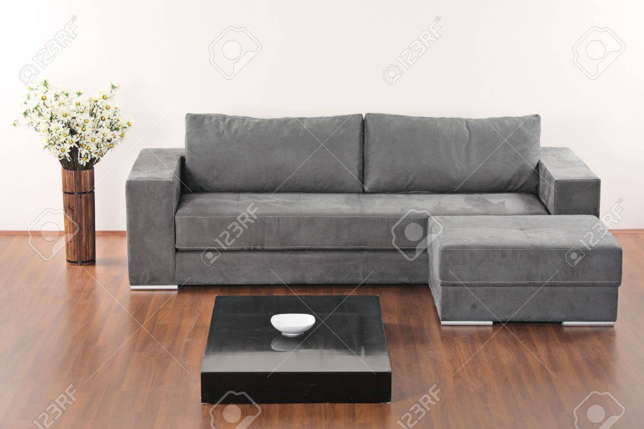 Minimalist Living Room Furniture A Modern Minimalist Living Room With Grey Furniture Stock Photo