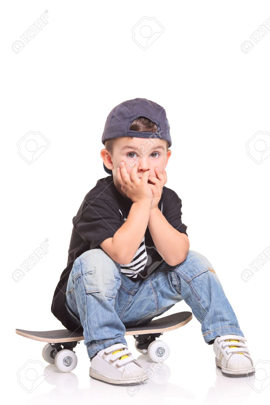 Little child sitting on a skateboard isolated on white background Stock Photo - 5559821