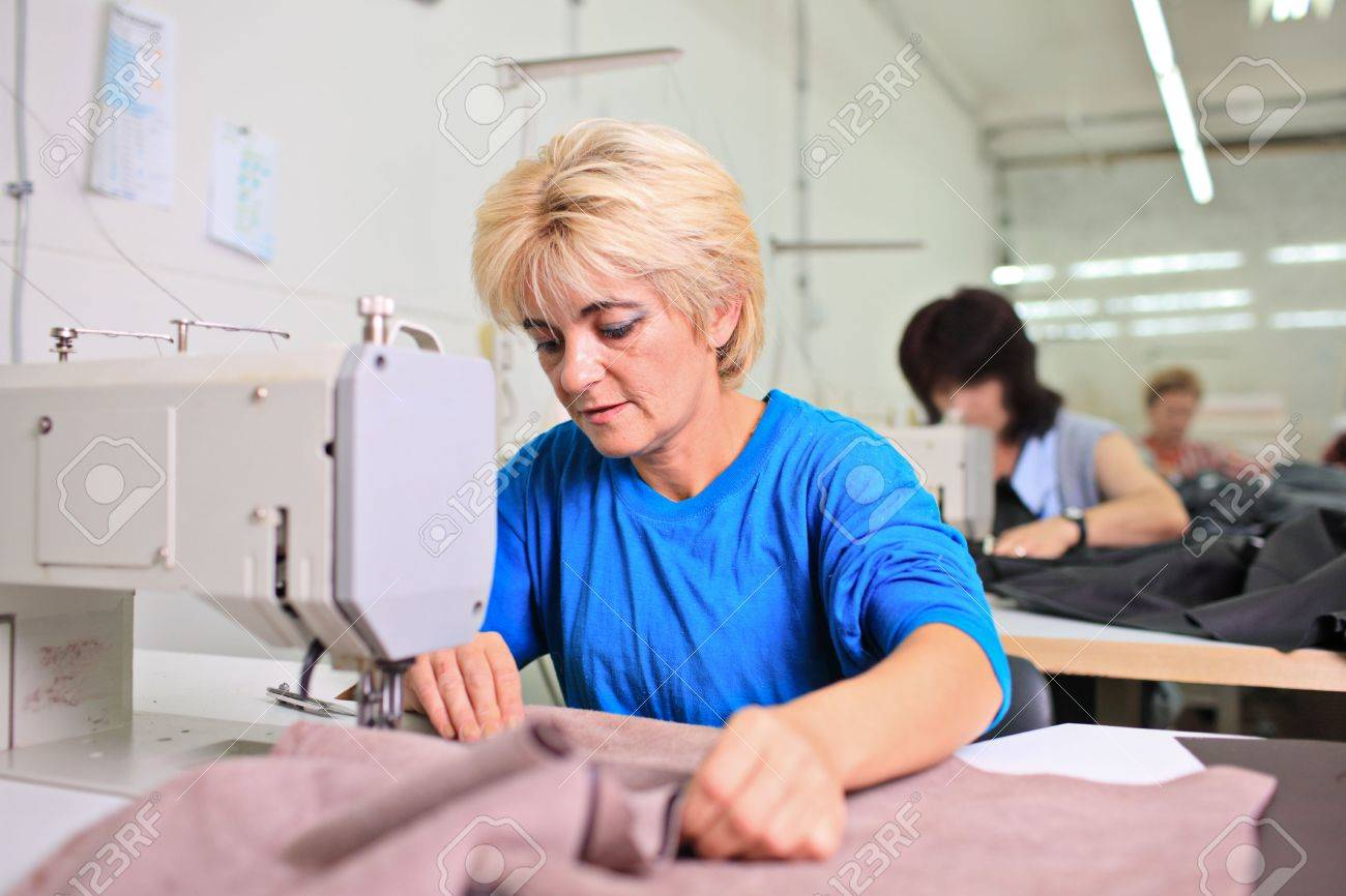 Tailor working at a textile factory Stock Photo - 5716989