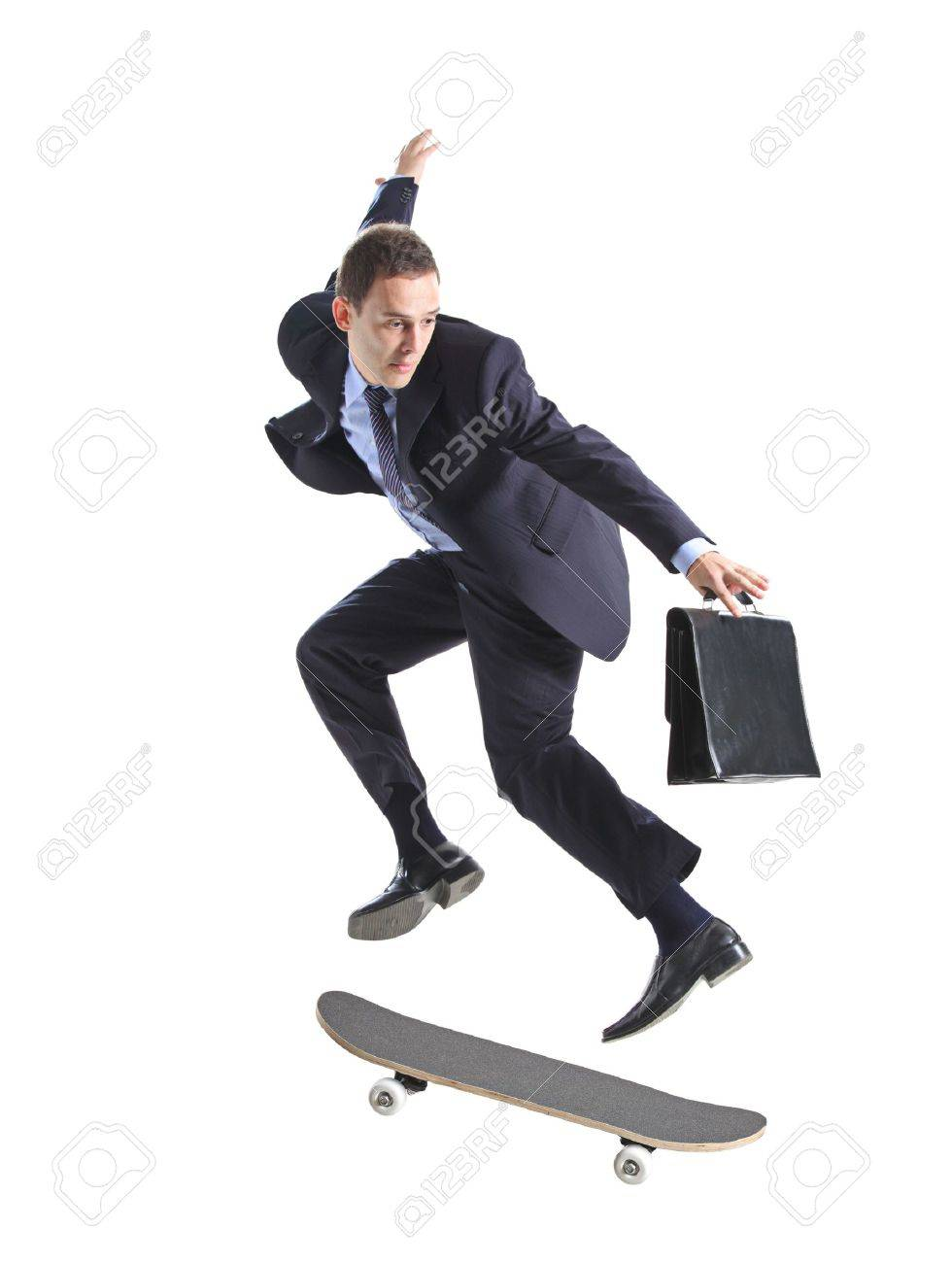 A businessman with skateboard jumping isolated on a white background Stock Photo - 5915204