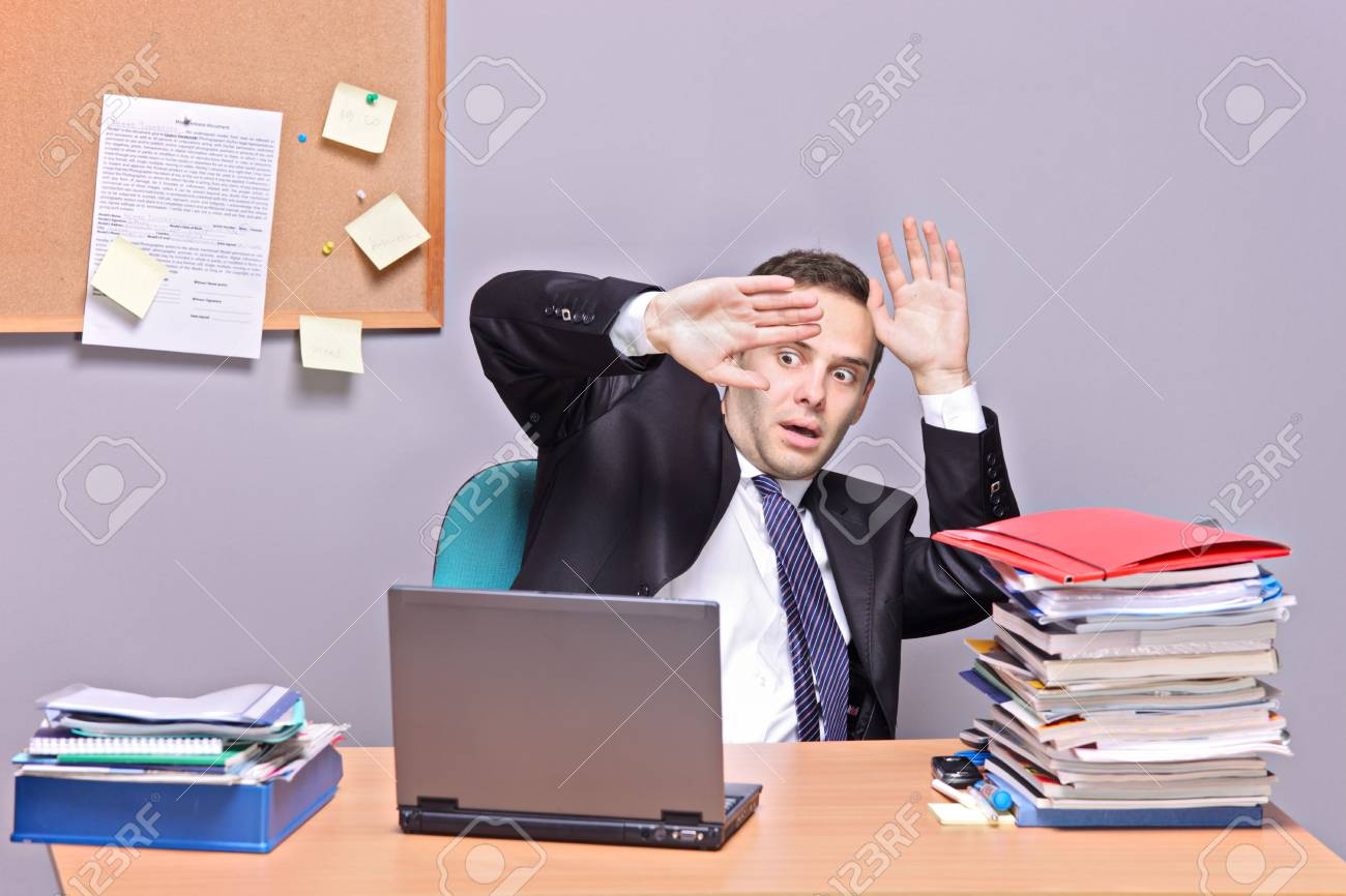 Frightened businessman in an office Stock Photo - 5945242