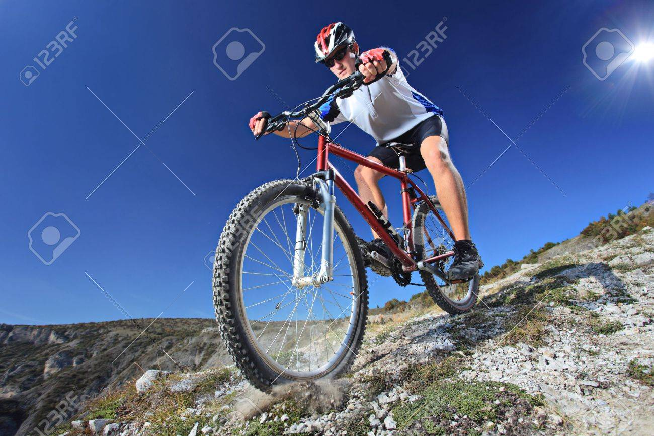 Person riding a bike downhill style Stock Photo - 6625478