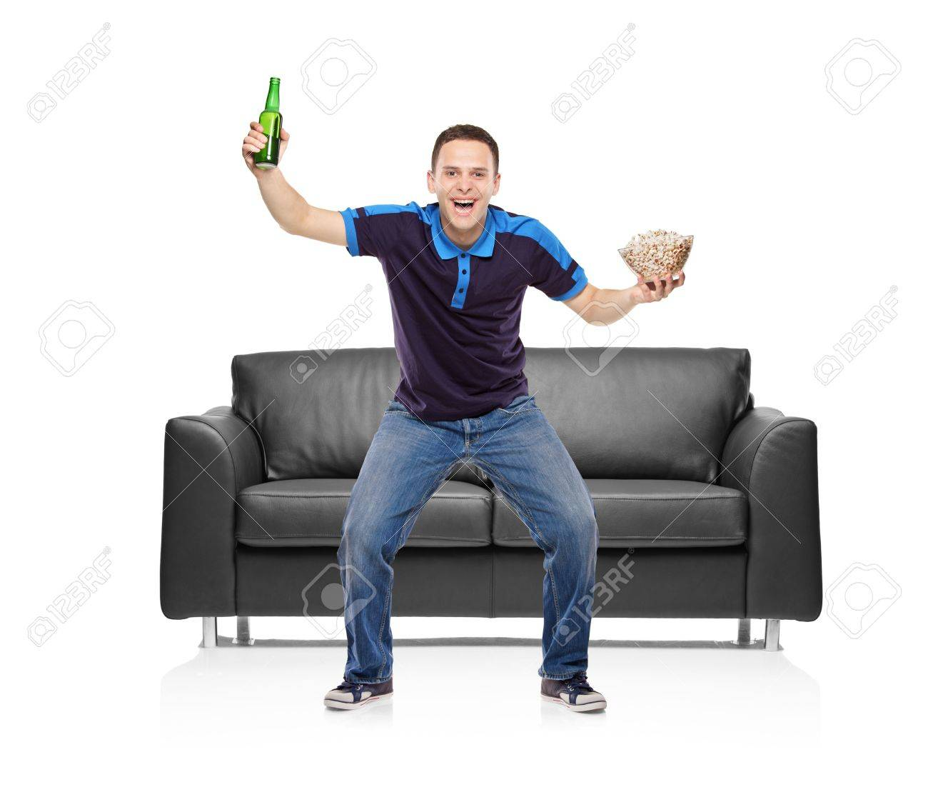 Sport fan with a beer bottle and popcorn bowl in his hands isolated on white background Stock Photo - 6997060