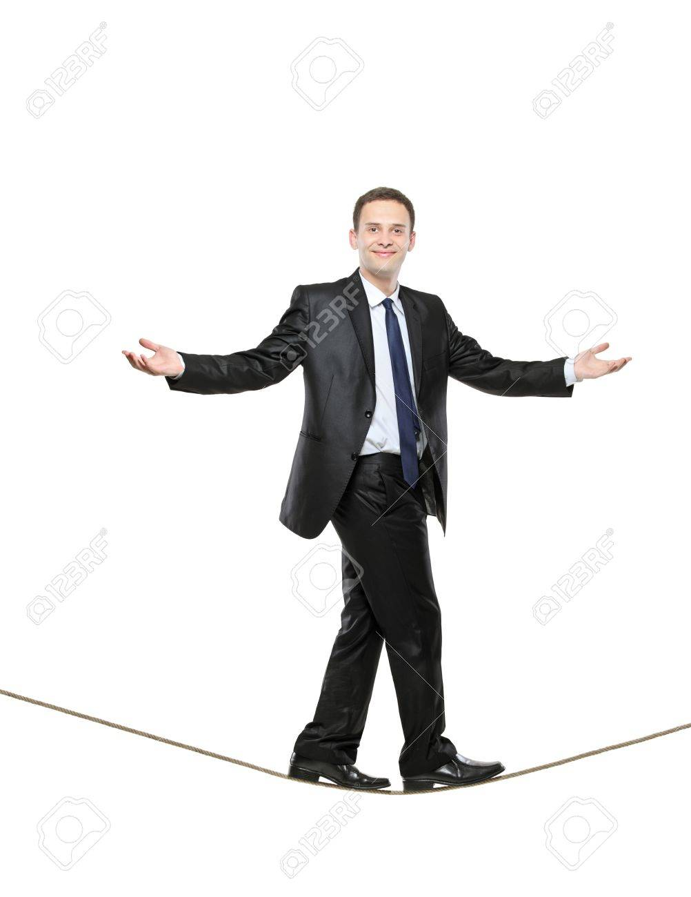 A business man walking on a high tightrope isolated on white background Stock Photo - 6971062