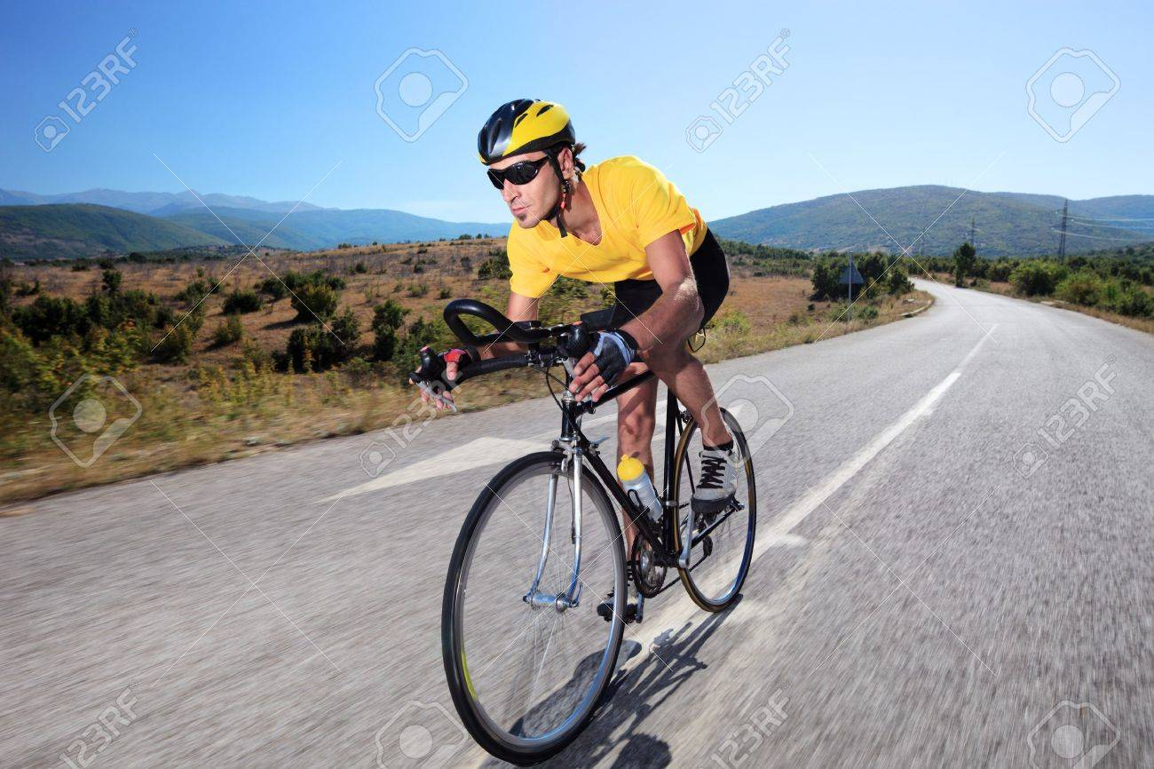 Cyclist riding a bike on an open road Stock Photo - 7776168