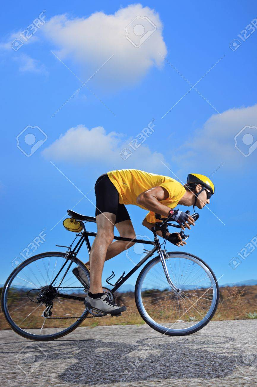 Cyclist riding a bike on an open road in Macedonia Stock Photo - 7776272
