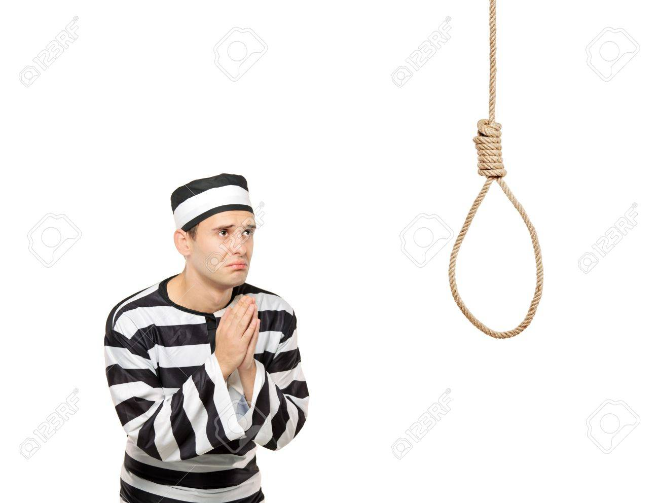 A sad prisoner with both hands clasp in begging gesture with a hanging noose against white background Stock Photo - 8038051