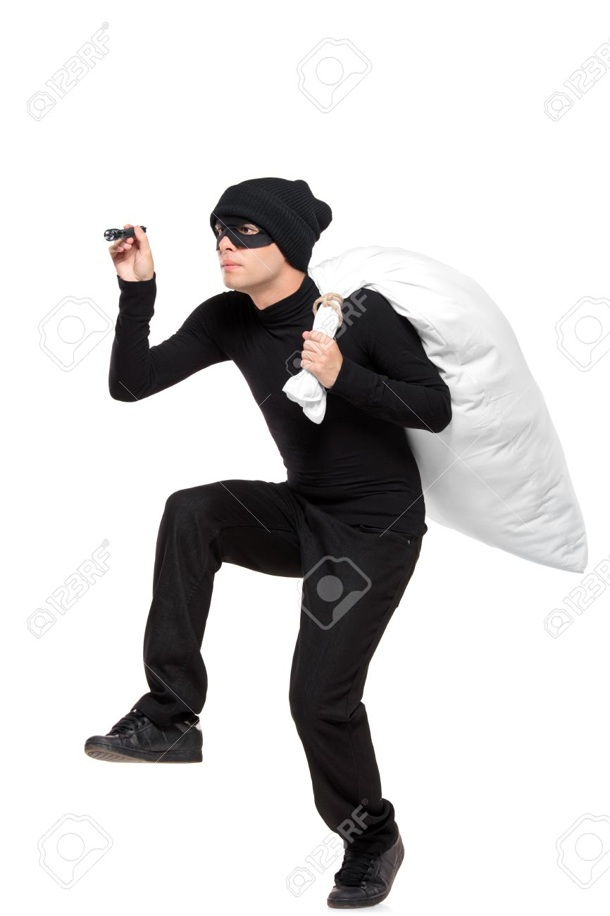 Full length portait of a robber with a bag and flashlight in hands isolated against white background Stock Photo - 8249269