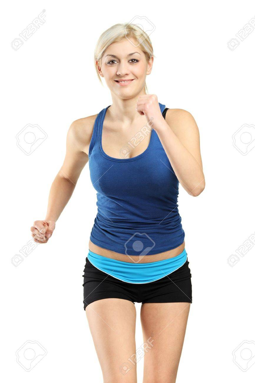 A view of a female runner running isolated against white background Stock Photo - 8646323