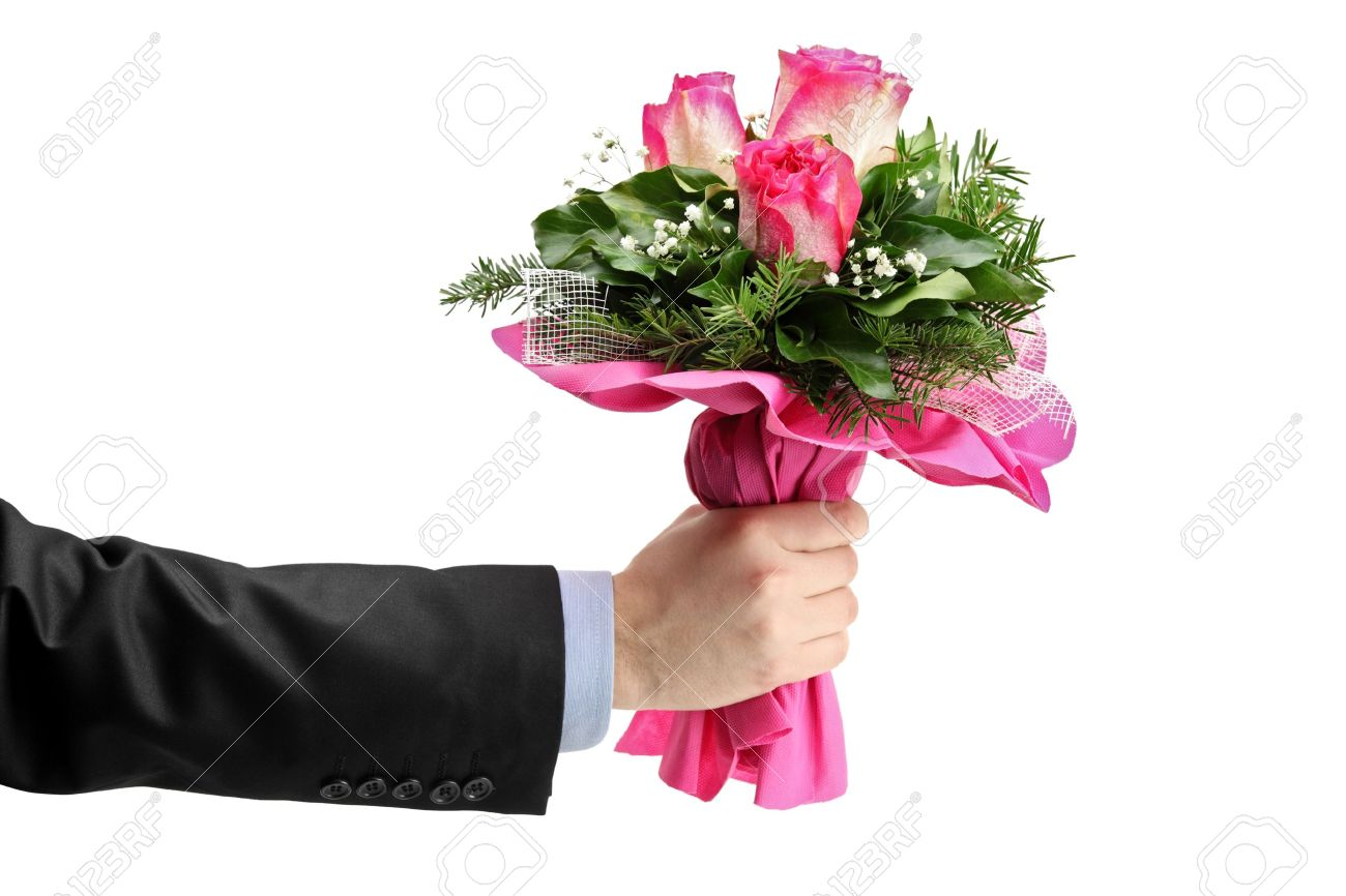 Hand holding bunch of roses isolated against white background Stock Photo - 8711585
