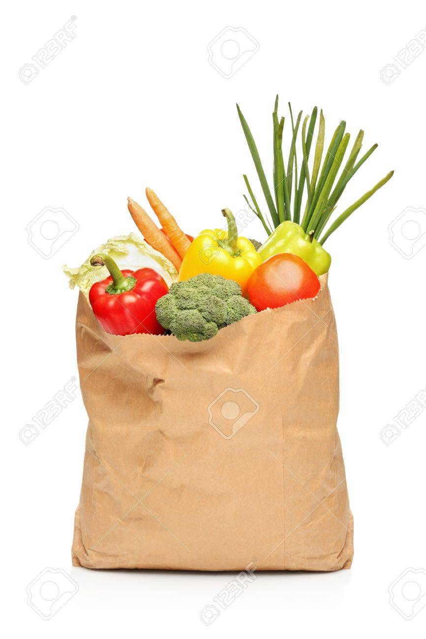 A Grocery Bag Full With Fresh Vegetables Isolated On White ...
