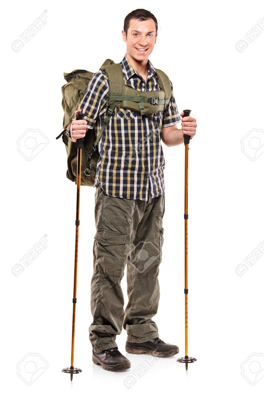 Full length portrait of a man in sportswear with backpack and hiking poles isolated on white background Stock Photo - 9093751