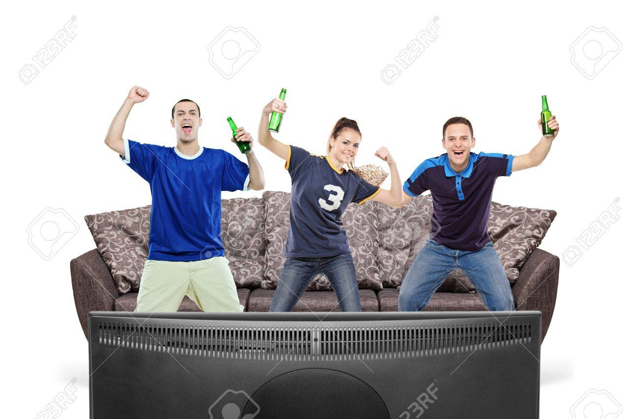 Three sport fans watching TV isolated against white background Stock Photo - 9239975