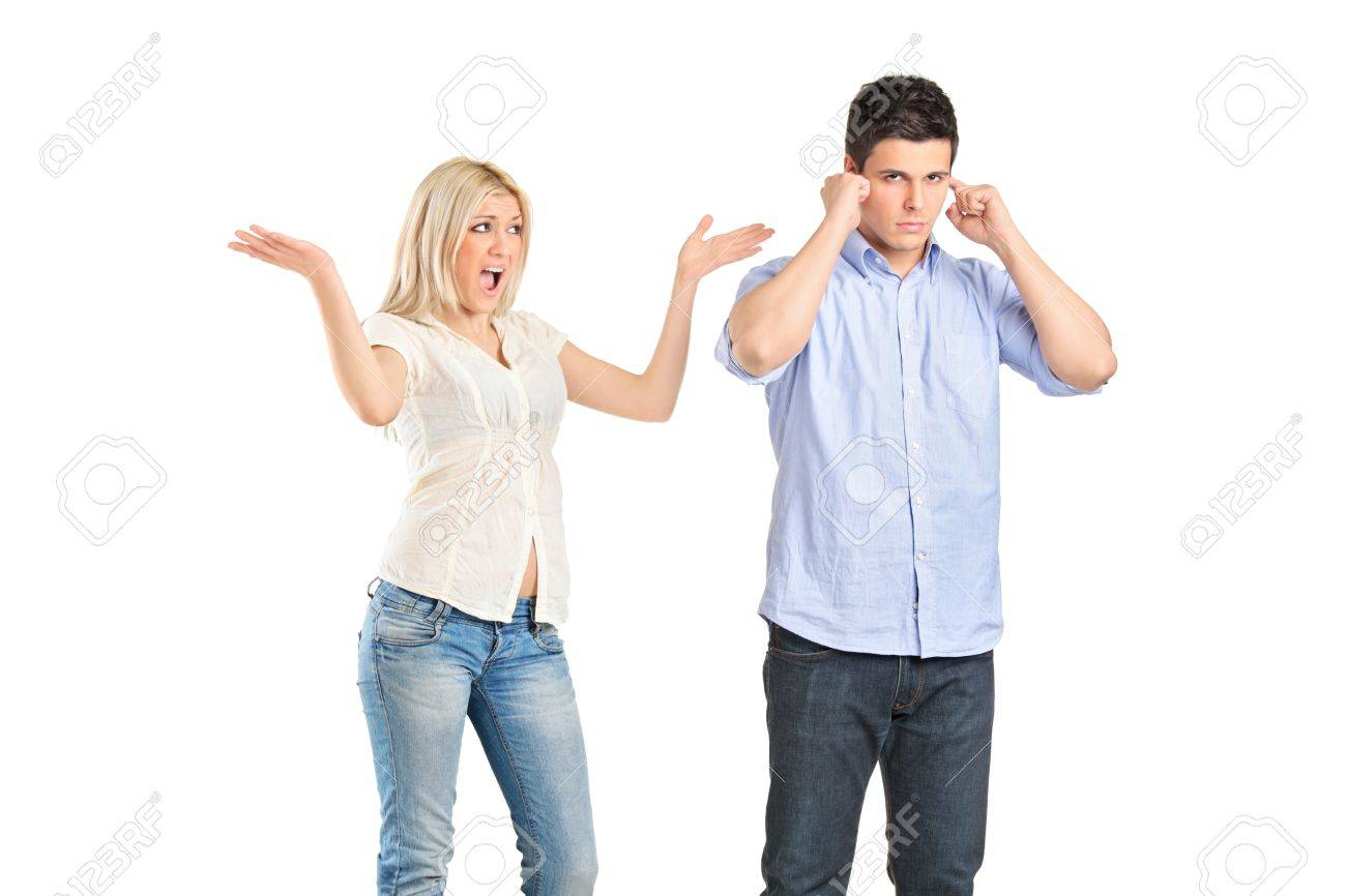 A girlfriend yelling to her boyfriend who is covering his ears isolated on white background Stock Photo - 9507990