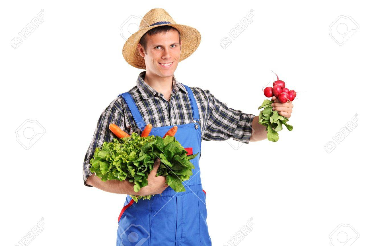 A young farmer holding vegetables isolated on white background Stock Photo - 9683291