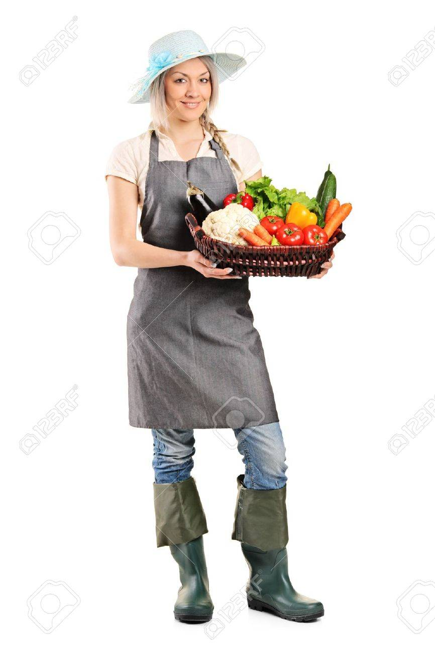 Full length portrait of a female gardener holding a basket of vegetables isolated on white background Stock Photo - 9731731