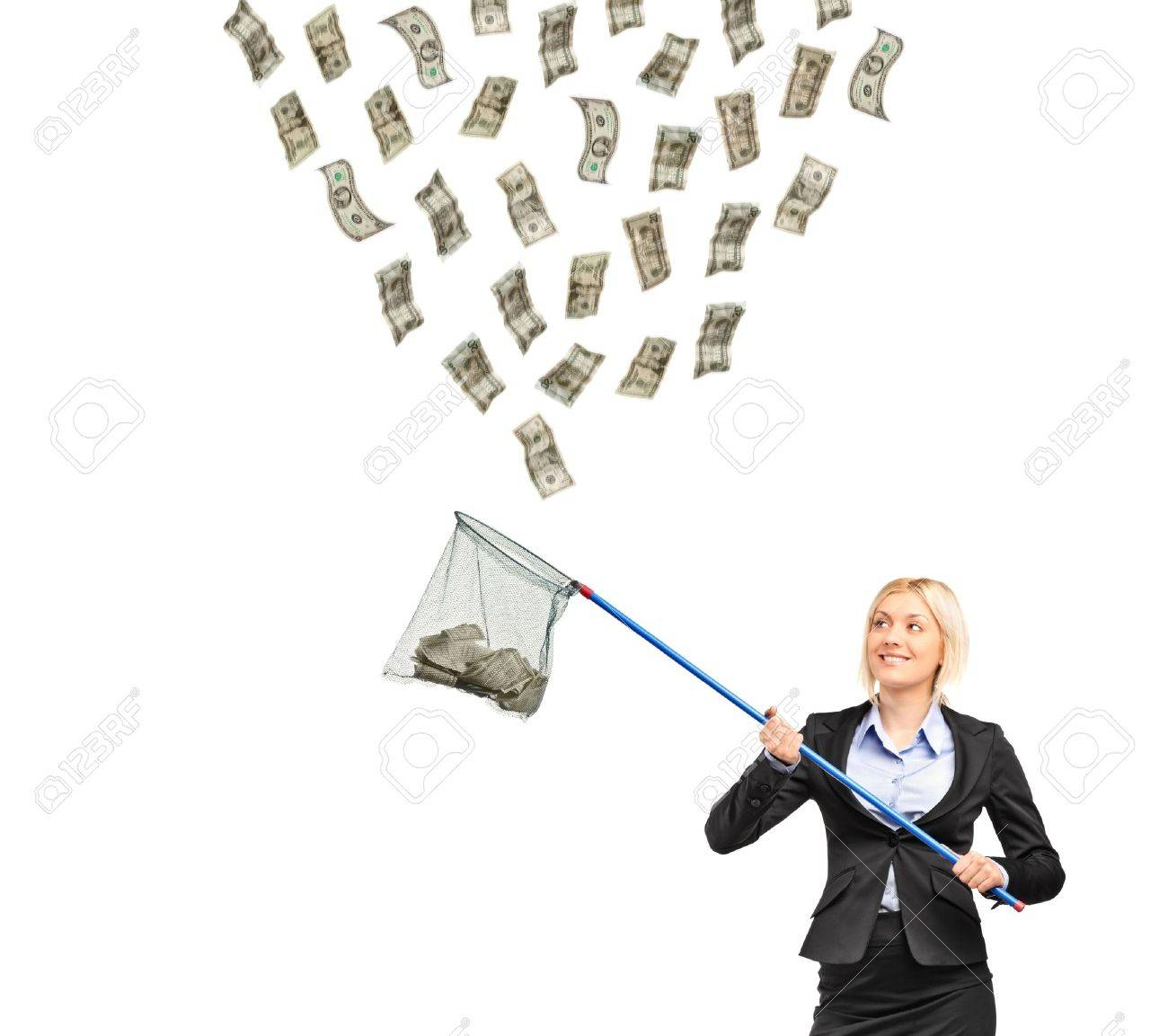 A businesswoman with a  net trying to catch money isolated on white background Stock Photo - 9814740
