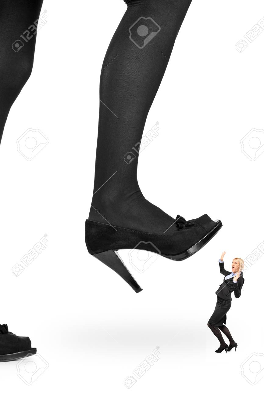 Big woman shoe stepping on a businesswoman isolated on white background Stock Photo - 9825813