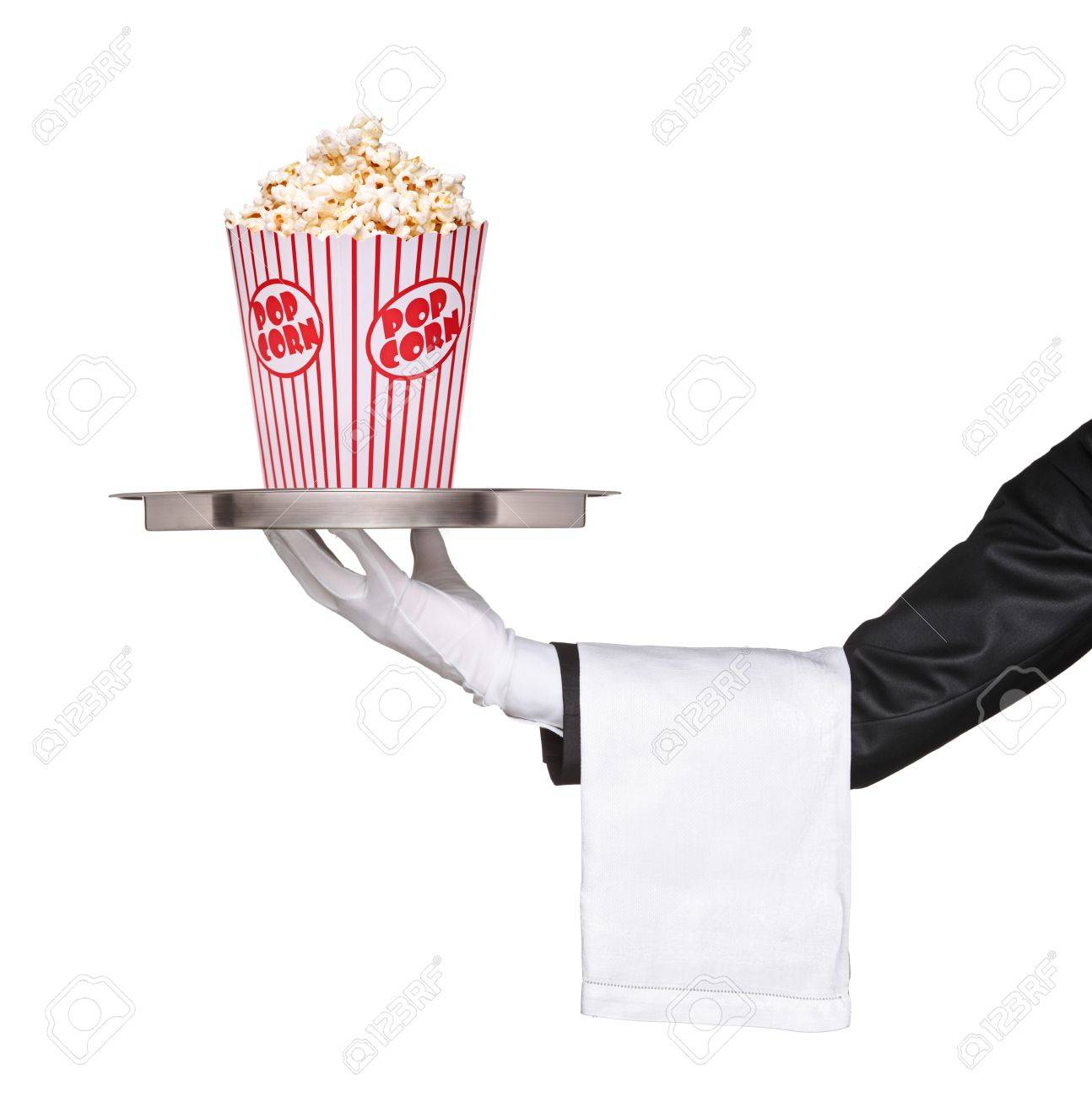 A waiter holding a silver tray with popcorn box on it isolated on white background Stock Photo - 10105413